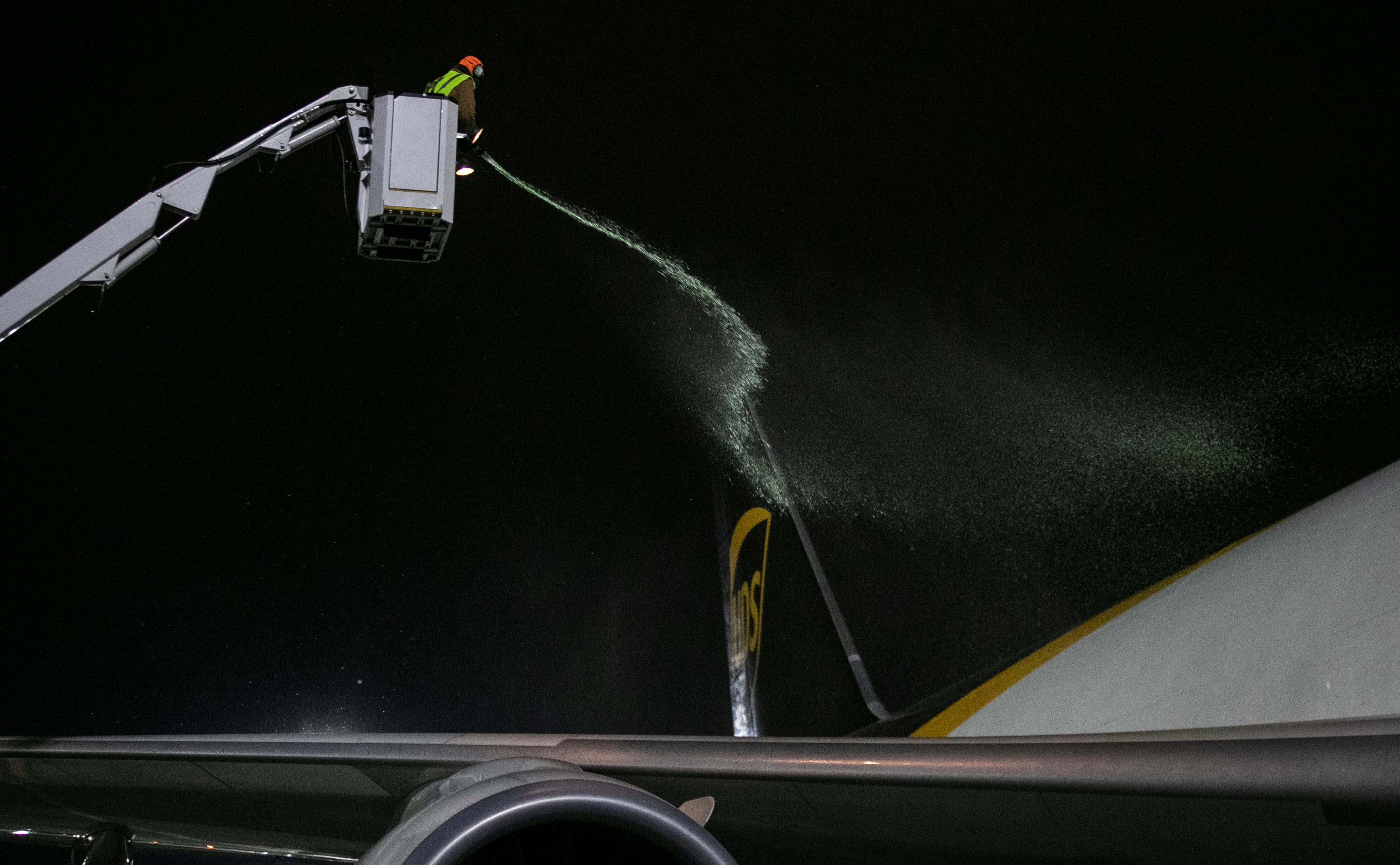 1:53 AM  Deicing fluid is sprayed on the tail of a UPS plane on Jan. 21, 2020. Around 125 UPS planes land each night at Louisville Muhammad Ali International Airport, with around 1.2 million packages sorted.