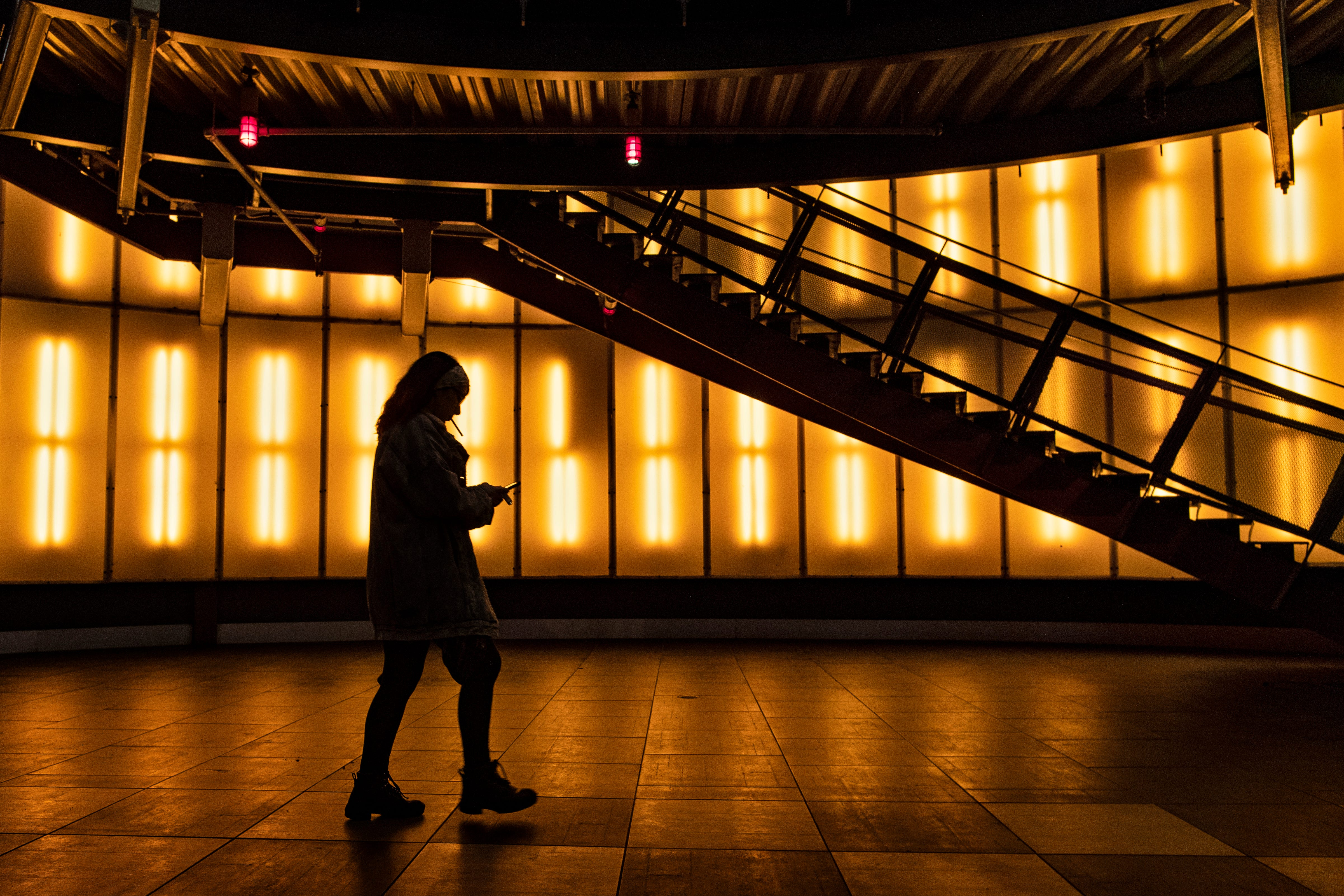 11:07 PM  A Fourth Street Live visitor makes their way past the illuminated staircase on a slow evening on Jan. 13, 2020.