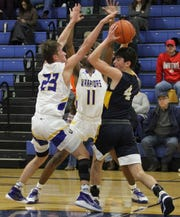 Ontario's Griffin Shaver and Shaquan Coburn attempt to trap Norwalk guard Will Gehlhausen, who had a career-night, making six 3-pointers en route to a game-high 20 points in the Truckers' 65-45 victory.