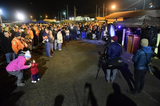 Speakers at Amy Fowler's candlelight vigil prayed for her full recovery and spoke of the bond shared by families of steelworkers.