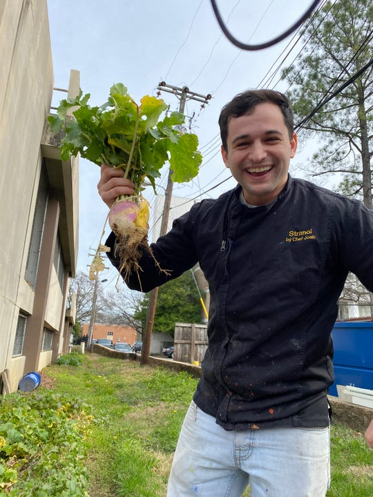 Chef Josh Steiner of Strano by Chef Josh picks vegetables he grows in a garden behind his East Memphis restaurant.