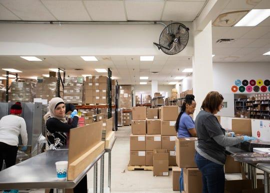 Workers inside Memphis Record Pressing vinyl plant in Bartlett, Tenn., on Wednesday, Jan. 28, 2020.