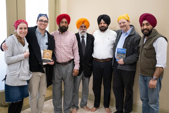 From left to right, Michal Wachtel, Benjamin Wachtel, Tej Bikram Singh, Sukhden Singh Dhillon, Dilbag Singh, Jason Caplan, and Vaneet Singh, inside the Mid South Sikh Sabha, Sunday, Jan. 19, 2020, in Cordova, Tenn.