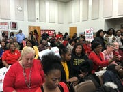 More than 100 Memphis teachers attended the January board meeting dressed in 'Red for Ed,' asking the district to update requirements of professional development.