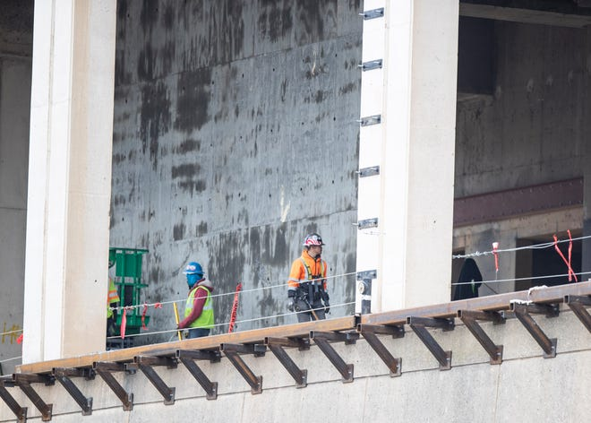 A construction crew works on site for the Renasant Convention Center renovation project on Wednesday, Jan. 29, 2020.
