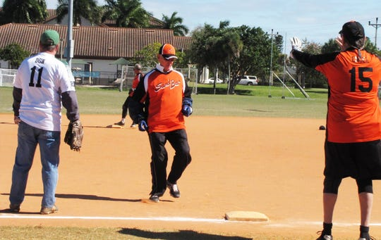 Mike Puskar is held up at third base by Sand Bar Coach Jerry Engel, as Stonewalls Don Schwartz watches the action.