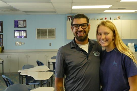 Michael Butler, English teacher, and Rachel Drake, junior, smile to the camera in a classroom in Marco Island Academy on Jan. 28, 2020.