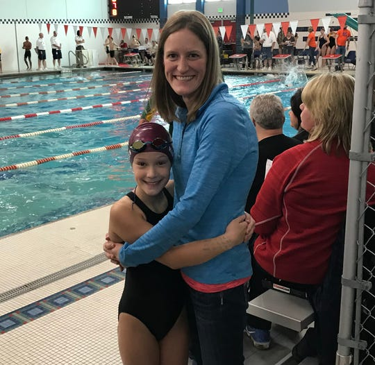 Tessa Hansen, left, broke her mom Sandy's 32-year-old record for the Lake Country Swim Team.