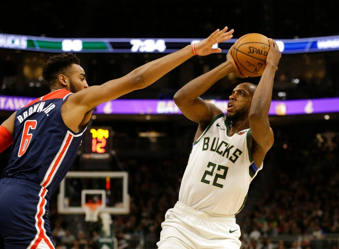 Bucks forward Khris Middleton puts up a shot over Washington's Troy Brown Jr. Middleton scored 51 points Tuesday night.