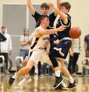Brookfield Academy guard Aidan Clarey gets a pass off while being trapped by Lake Country Lutheran during a game on Jan. 28, 2020.