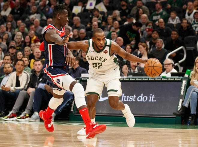 Khris Middleton drives to the basket against Wizards forward Isaac Bonga Tuesday night.  Middleton scored a career-high 51 points.