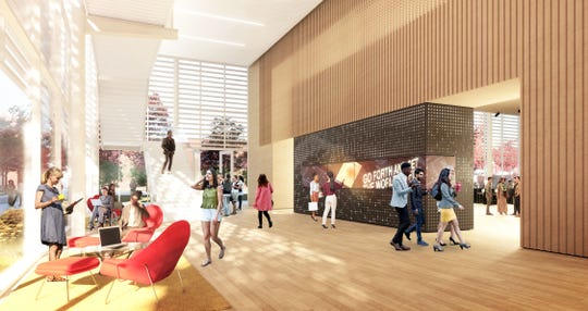 A rendering of the lobby and statement wall at Marquette's new College of Business building.