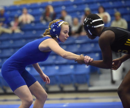 Mountain Home's Dani Frencl grapples with her Jonesboro opponent on Tuesday night.