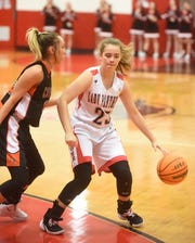 Norfork's Kylie Manes is defended by Calico Rock's Kaylee Pool during action earlier this season at Norfork. The Lady Panthers edged the Lady Pirates 45-43 on Tuesday night at Calico Rock.