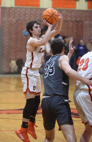 Viola's Gage Harris launches a 3-pointer against Izard County on Tuesday night. Harris surpassed 2,000 career points during the game.