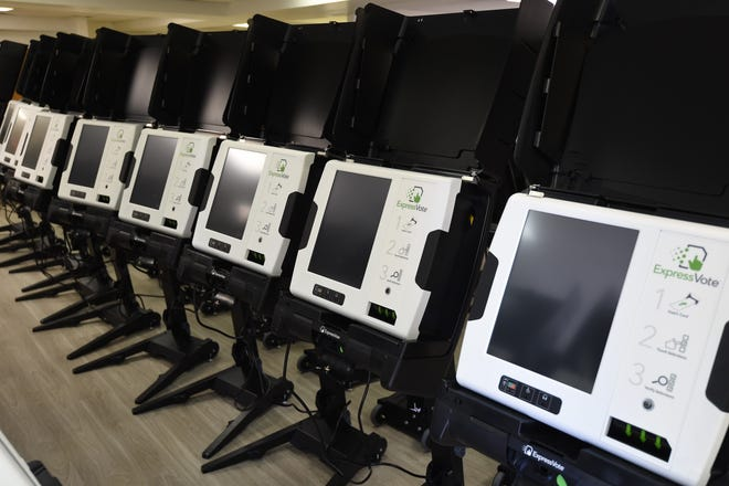A line of ExpressVote voting machines is seen earlier this month at the Baxter County Election Commission office. The county recently purchased 82 of the machines, which will be used in the March 3 primary election.