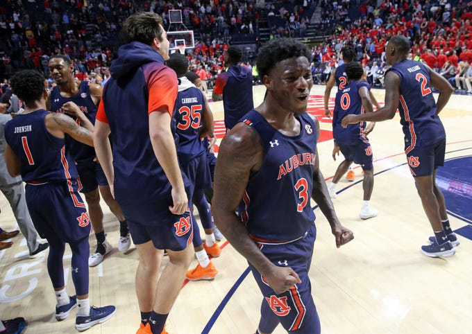 Jan 28, 2020; Oxford, Mississippi, USA; Auburn Tigers forward Danjel Purifoy (3) celebrates with teammates after the Auburn Tigers beat the Mississippi Rebel is double overtime at The Pavilion at Ole Miss. Mandatory Credit: Petre Thomas-USA TODAY Sports