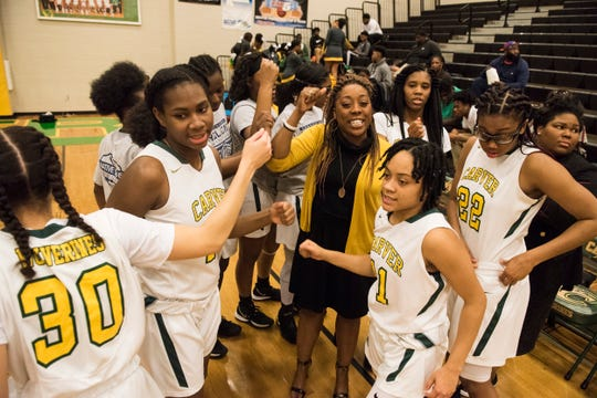 Carver coach Adria Harris huddles with her team before the game at Carver High School in Montgomery, Ala., on Tuesday, Jan. 28, 2020. Carver defeated Opelika 70-52.
