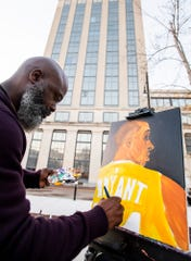 Kevin King paints a portrait of NBA great Kobe Bryant as artists gather to mourn and remember him in downtown Montgomery, Ala., on Tuesday evening January 28, 2020.