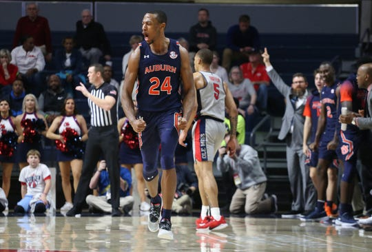 Auburn center Anfernee McLemore (24) celebrates after making a 3 against Ole Miss on Jan. 28, 2020.