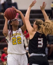 Carver's Mya Barnes (22) goes up for a shot over Opelika's Claire Worth (3) at Carver High School in Montgomery, Ala., on Tuesday, Jan. 28, 2020. Carver defeated Opelika 70-52.