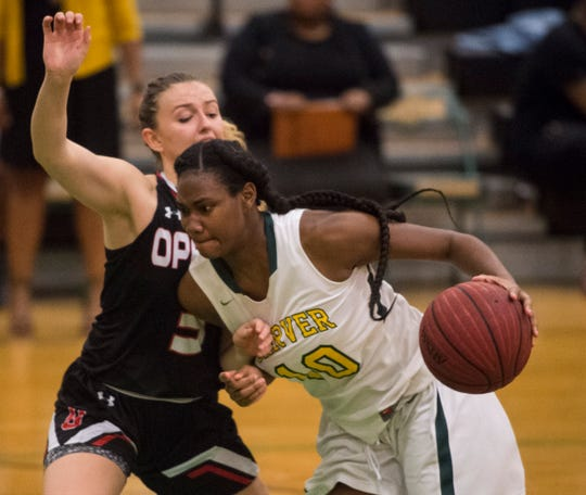 Carver's Bre'Anna Rhodes (10) drives the lane at Carver High School in Montgomery, Ala., on Tuesday, Jan. 28, 2020. Carver defeated Opelika 70-52.