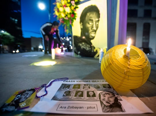 Artists gather in downtown Montgomery, Ala., on Tuesday evening January 28, 2020 to mourn and remember NBA great Kobe Bryant, and the others killed in the helicopter crash that took his life.
