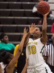 Carver's Bre'Anna Rhodes (10) goes up for a layup at Carver High School in Montgomery, Ala., on Tuesday, Jan. 28, 2020. Carver defeated Opelika 70-52.