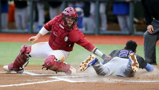 Alabama catcher Sam Praytor lunges with a tag but can't get Presbyterian runner Jonathan White in time as the Crimson Tide played game 3 of the weekend series with Presbyterian in Sewell-Thomas Stadium Saturday, Feb. 16, 2019.  [Staff Photo/Gary Cosby Jr.]