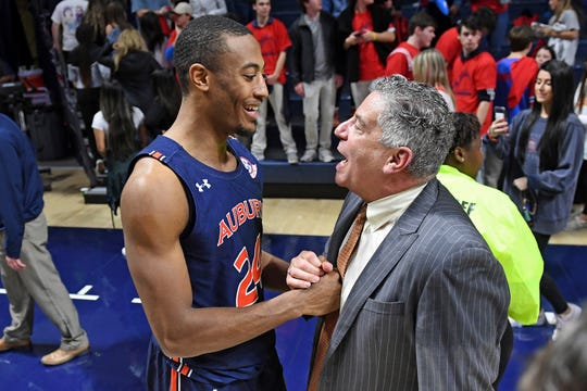 Auburn forward Anfernee McLemore talks with coach Bruce Pearl after a win over Ole Miss in Oxford, Miss., on Tuesday, Jan. 28, 2020.