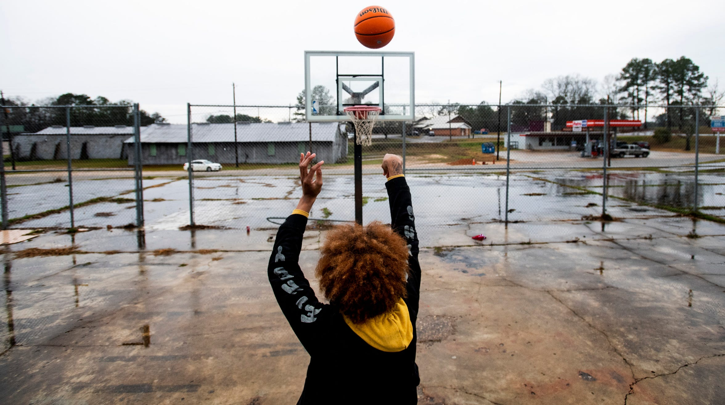 J.D. Davison shoots hoops on an outdoor public court, known as The Cage, in Fort Deposit, Ala., on Wednesday January 29, 2020.  Davison plays at Calhoun.