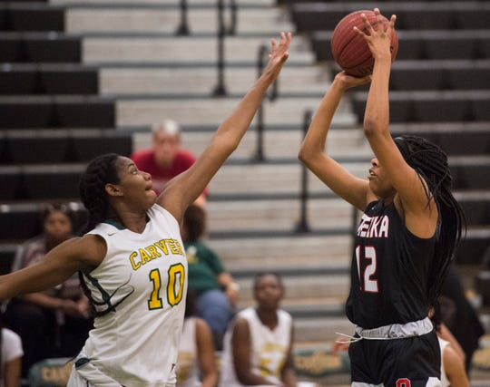 Opelika's Kaitlyn Bryant (12) takes a jump shot over Carver's Bre'Anna Rhodes (10) at Carver High School in Montgomery, Ala., on Tuesday, Jan. 28, 2020. Carver defeated Opelika 70-52.