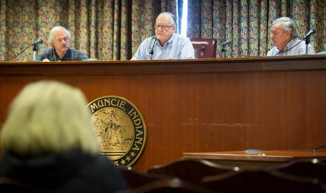 Joseph Evans, Bill Smith and Mike Cline hold the Jan. 29 meeting of the Muncie Sanitary Board. The meeting was the first following a lawsuit that was filed by the city over placing the city engineer on the board.