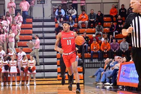 Ball State redshirt freshman guard Jarron Coleman moves the ball during the Cardinals' game Tuesday against Bowling Green. The Falcons beat BSU.