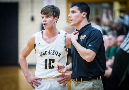 Winchester's Wayde Sickels (left) and coach Dustin Baldwin (right) talk during their game against Yorktown at Winchester Fieldhouse Tuesday, Jan. 28, 2020.