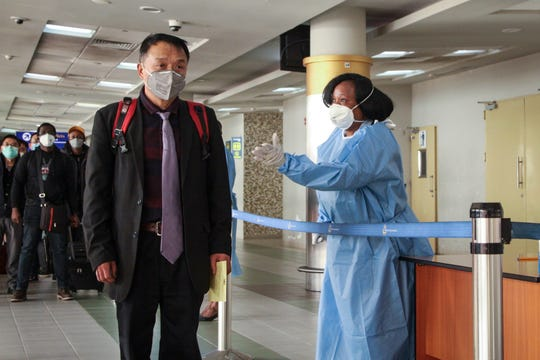 Passengers arriving from a China Southern Airlines flight from Changsha in China are screened for the new type of coronavirus, whose symptoms are similar to the cold or flu and many other illnesses, upon their arrival at the Jomo Kenyatta international airport in Nairobi, Kenya Wednesday, Jan. 29, 2020. Some countries began evacuating their citizens Wednesday from Wuhan, the Chinese city hardest-hit by an outbreak of the new virus that is thought to have killed over one hundred people and infected more than 6,000.