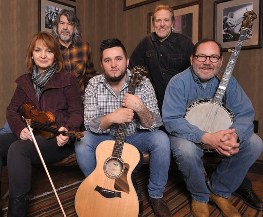 Members of the SteelDrivers — Tammy Rogers, Brent Truitt, Kelvin Damrell, Mike Fleming and Richard Bailey — pose in a dressing room at the Grand Ole Opry House in Nashville on Tuesday, Jan. 28, 2020.