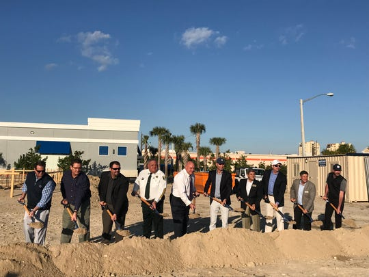 PopStroke founder Greg Bartoli, center in blue ballcap, and representatives from other entities involved in the project, broke ground at the Fort Myers facility on Wednesday, Jan. 29, 2020.
