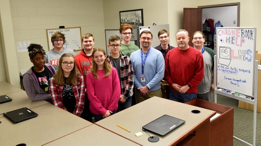 Mike Haudenschild and Tim Owen with their team of student interns who operate the district's technology center at Lakewood High School.