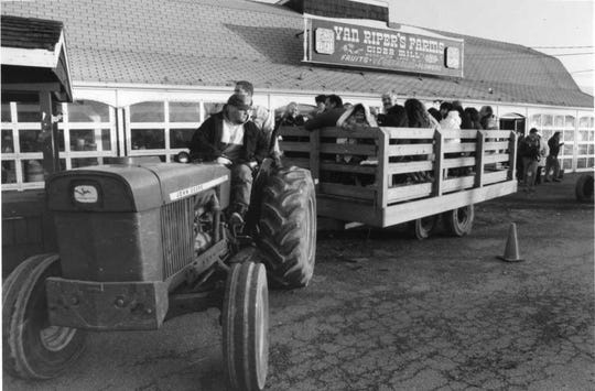 . Well-wishers taking a final hay ride  at Van Riper's Farm in Woodcliff Lake, in January 1995.