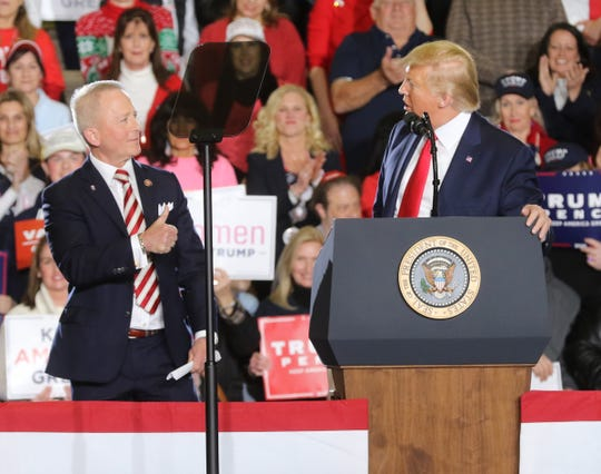 Rep. Jeff Van Drew, left, who switched from the Democratic Party to become a Republican late last year, appears with President Donald Trump at a rally in Wildwood on Tuesday, Jan. 28, 2020.