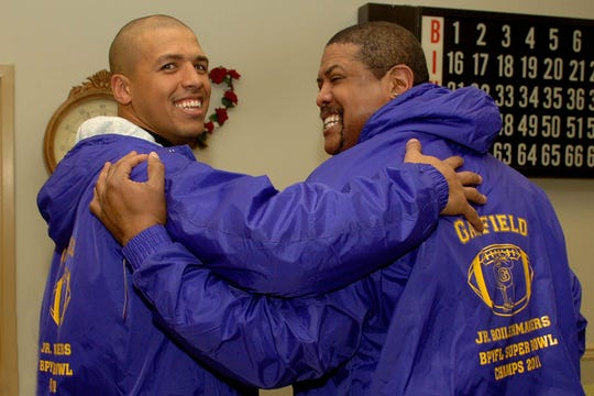 Miles Austin and his dad, Miles Sr., are all smiles as they don new Junior Boilermakers Superbowl Winner jackets in 2012. Miles Austin is now an assistant coach for the 49ers, who are playing in Super Bowl LIV.