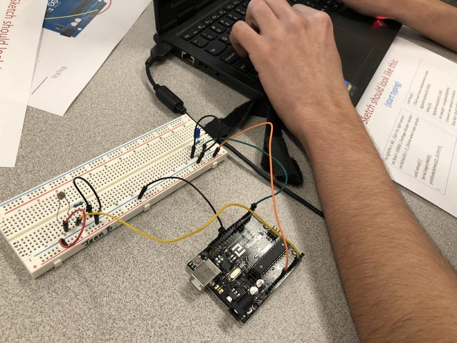 A microprocessor and programming were essential tools in completing this weather project by the Deming High School Special Ed. students in D level.