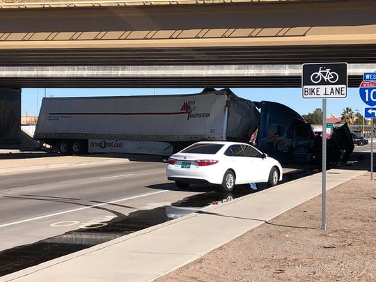 The driver of this white vehicle was described as being in a state of shock after a tractor trailer almost crushed it after driving off the Interstate-10 ramp on Tuesday, Jan. 28.