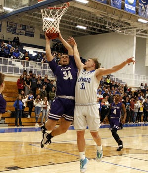 Clovis' Bryce Cabledue (34) and Carlsbad's Ayden Parent (33) battle for a rebound in the first half of their district opener on Jan. 28, 2020. Clovis won, 44-32.