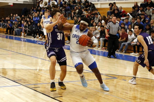 Carlsbad's Shamar Smith drives the lane against Clovis in the first half of Tuesday's game. Smith scored 11 points. Clovis won, 44-32.