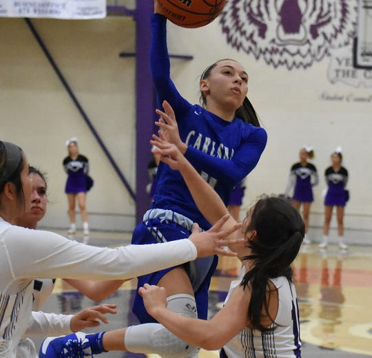 Carlsbad guard Baylee Molina whips a pass to the corner in the third quarter of Tuesday's District 4-5A game at Rock Staubus Gymnasium.