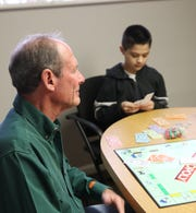 Dave Beavers, left, says the Big Brothers Big Sisters of San Juan County mentoring program offers as much for the adults who take part in it as it does for the children it is designed to benefit, including his match, Gabriel Gonzales.