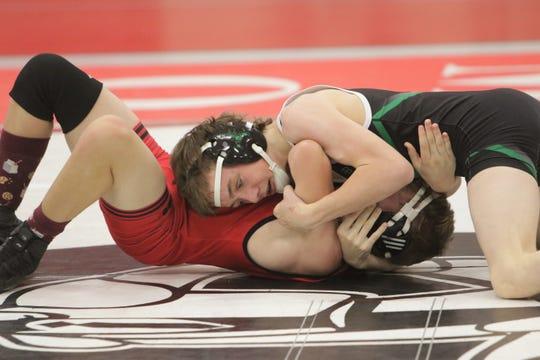 Farmington's Trey Colebrook pins Durango's Chris McGrath in a 120-pound division match during Tuesday's wrestling duals at Hermosa Middle School in Farmington.