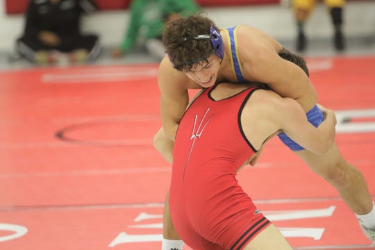 Bloomfield's JT Seitzinger fights to stay on his feet against Durango's Gabe Vasquez in a 152-pound division match during Tuesday's wrestling duals at Hermosa Middle School in Farmington.